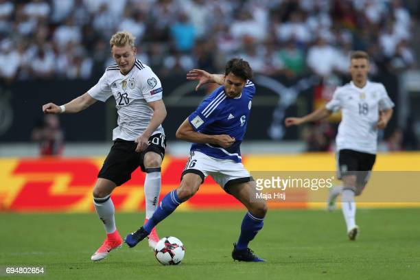 Julian Brandt of Germany and Davide Simoncini of San Marino battle for the ball during the FIFA 2018 World Cup Qualifier between Germany and San...