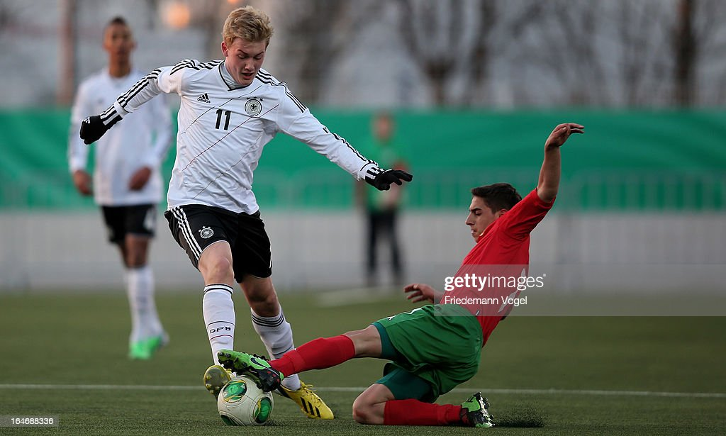 Julian Brandt of Germany and Emil Dobrinov Petrov of Bulgaria battle for the ball during the UEFA Under17 Elite Round match between Germany and Bulgaria at Toennies-Arena on March 26, 2013 in Rheda-Wiedenbruck, Germany.
