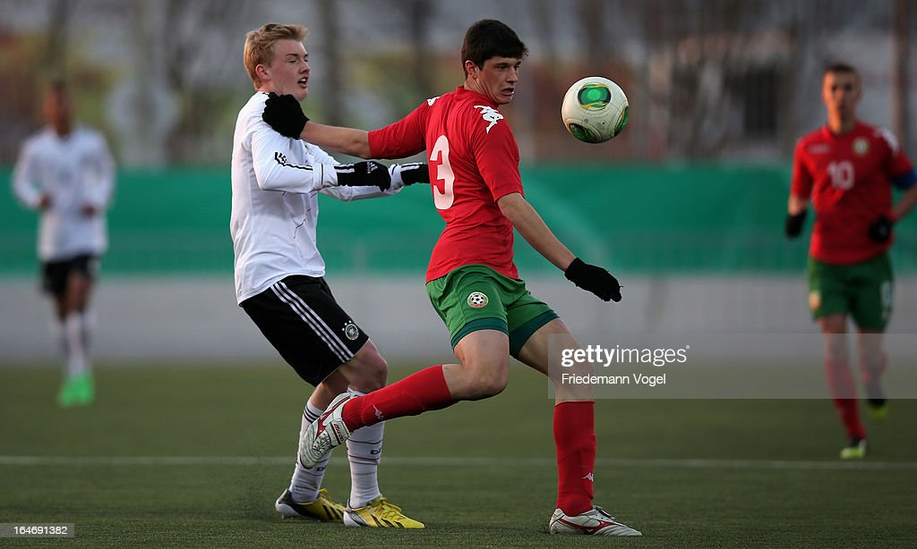 Julian Brandt of Germany and Stefan Ivov Velkov of Bulgaria battle for the ball during the UEFA Under17 Elite Round match between Germany and Bulgaria at Toennies-Arena on March 26, 2013 in Rheda-Wiedenbruck, Germany.