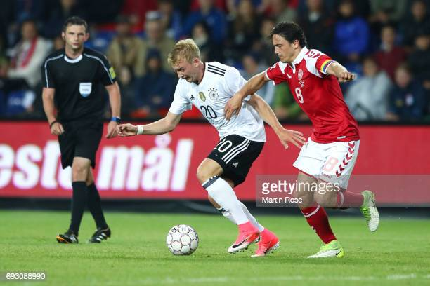 Julian Brandt of Germany and Thomas Delaney of Denmark battle for the ball during the international friendly match between Denmark v Germany on June...