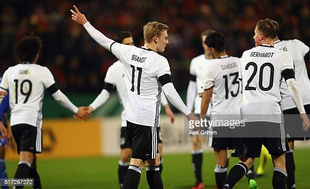 Julian Brandt of Germany celebrates his team's fourth goal with team mates during the 2017 UEFA European U21 Championships qualifier match between...