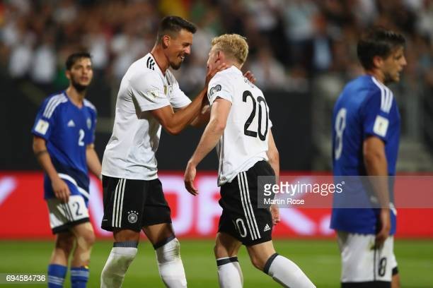 Julian Brandt of Germany celebrates scoring his sides sixith goal with Sandro Wagner of Germany during the FIFA 2018 World Cup Qualifier between...