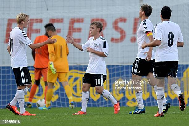 Julian Brandt of Germany celebrates with team mates after scoring their third goal during the U19 international friendly match between The...