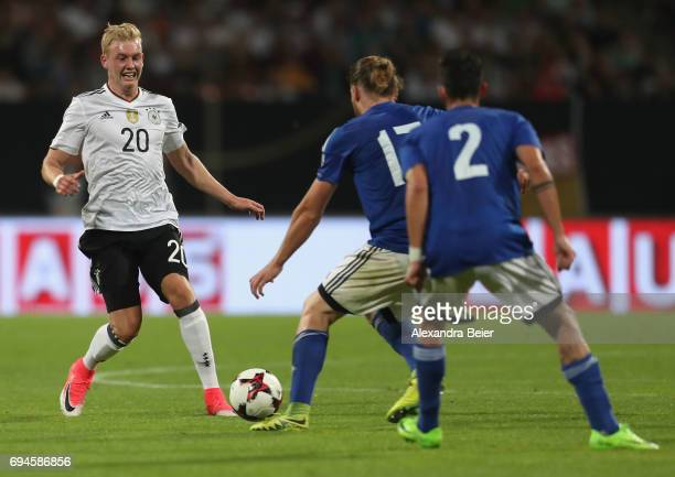 Julian Brandt of Germany fights for the ball with Juri Biordi and Davide Cesarini of San Marino during the FIFA 2018 World Cup Qualifier between...