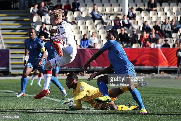 Julian Brandt of Germany jumps over goalkeeper Misiwani Nairobi of Fiji during the Group E Group E FIFA U20 World Cup New Zealand 2015 match between...