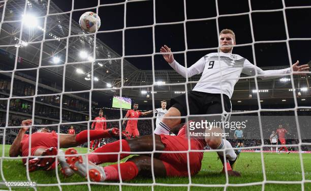 Julian Brandt of Germany scores his team's first goal past Anderson Santamaria of Peru and Luis Advincula of Peru challenged by Timo Werner of...