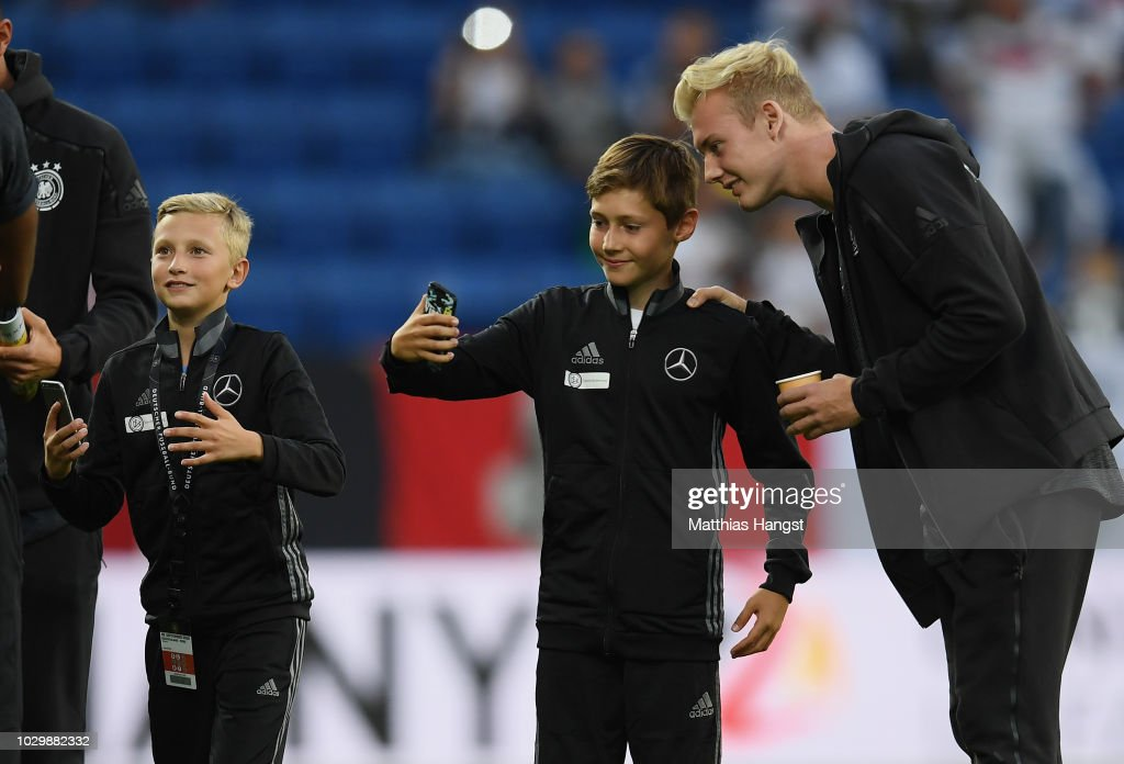 Julian Brandt of Germany takes photos with escort kids prior to the International Friendly match between Germany and Peru on September 9, 2018 in Sinsheim, Germany.