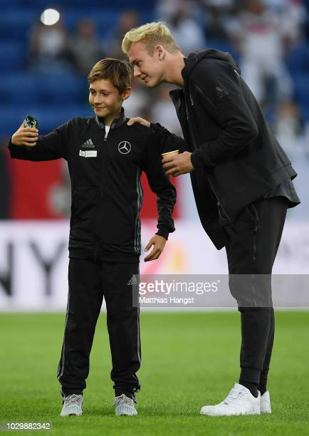 Julian Brandt of Germany takes photos with escort kids prior to the International Friendly match between Germany and Peru on September 9, 2018 in...
