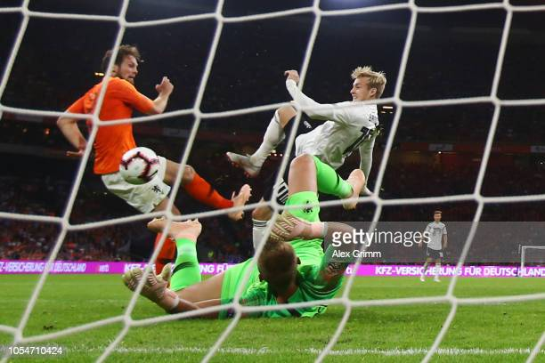 Julian Brandt of Germany tries to score past Daley Blind and goalkeeper Jasper Cillessen of Netherlands during the UEFA Nations League A group one...