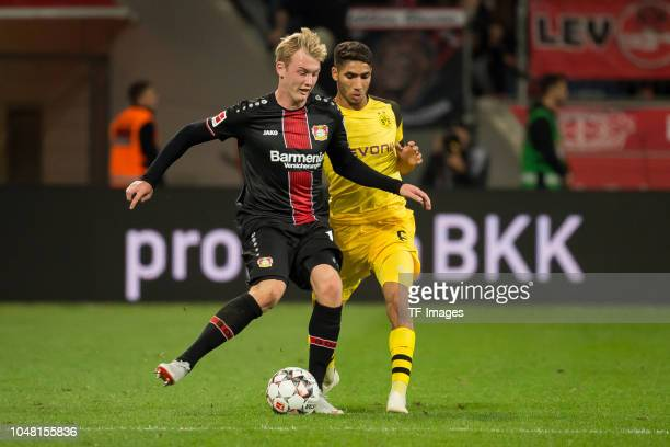 Julian Brandt of Leverkusen and Achraf Hakimi of Borussia Dortmund battle for the ball during the Bundesliga match between Bayer 04 Leverkusen and...