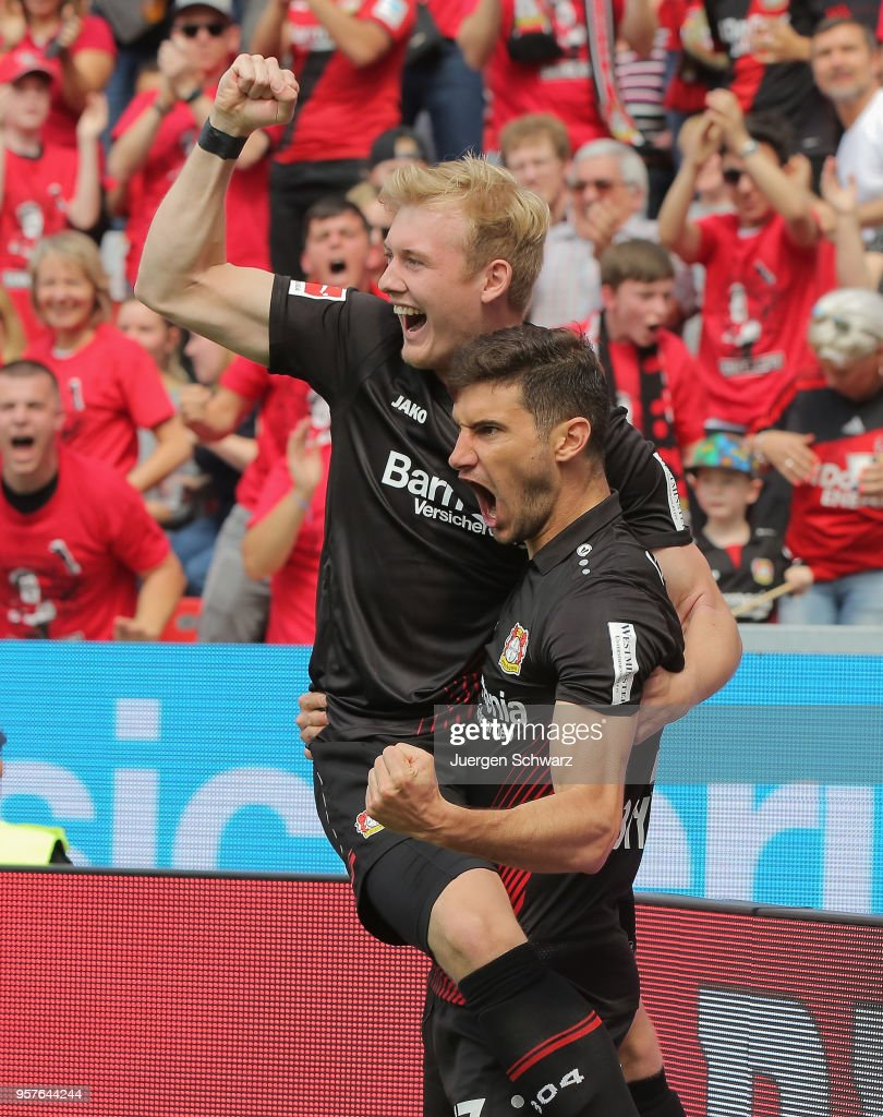 Julian Brandt of Leverkusen (L) and Lucas Alario celebrate after scoring during the Bundesliga match between Bayer 04 Leverkusen and Hannover 96 at BayArena on May 12, 2018 in Leverkusen, Germany.