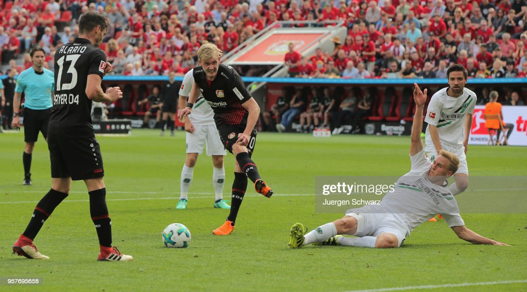 Julian Brandt of Leverkusen and Timo Huebers of Hannover (R) compete during the Bundesliga match between Bayer 04 Leverkusen and Hannover 96 at BayArena on May 12, 2018 in Leverkusen, Germany.