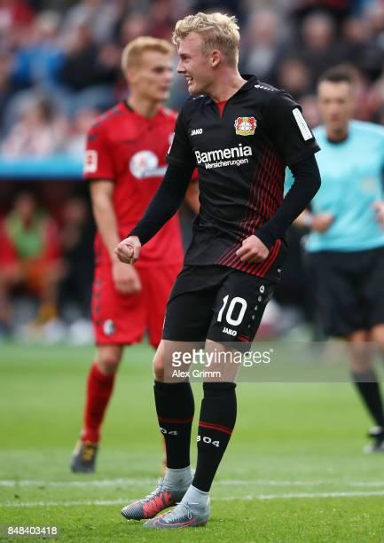 Julian Brandt of Leverkusen celebrates his team's fourth goal during the Bundesliga match between Bayer 04 Leverkusen and SC Freiburg at BayArena on...