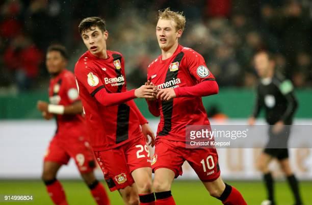 Julian Brandt of Leverkusen celebrates the first goal with Kai Havertz of Leverkusen during the DFB Cup quarter final match between Bayer Leverkusen...