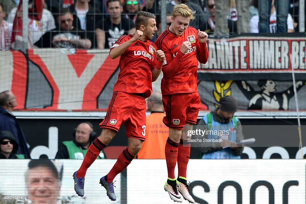 Julian Brandt (R) of Leverkusen celebrates with team mate Fladen Yurchenko after scoring the opening goal during the Bundesliga match between 1. FC Koeln and Bayer Leverkusen at RheinEnergieStadion on April 10, 2016 in Cologne, Germany.