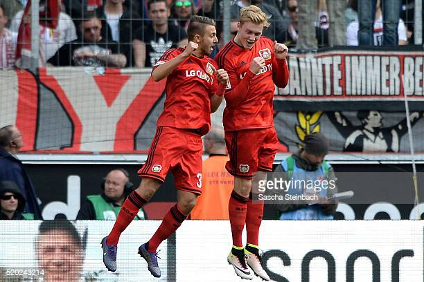 Julian Brandt of Leverkusen celebrates with team mate Fladen Yurchenko after scoring the opening goal during the Bundesliga match between 1 FC Koeln...
