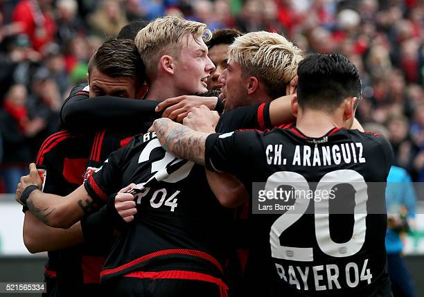 Julian Brandt of Leverkusen celebrates with team mates after scoring his teams second goal during the Bundesliga match between Bayer Leverkusen and...