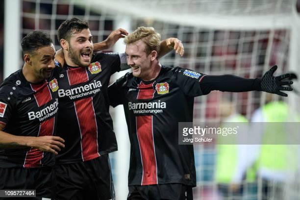 Julian Brandt of Leverkusen celebrates with teammates Kevin Volland and Karim Bellarabi their goal for the 1-3 lead during the Bundesliga match...
