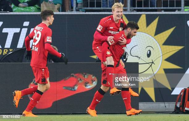 Julian Brandt of Leverkusen jubilates with team mates after scoring the second goal during the Bundesliga match between VfL Wolfsburg and Bayer 04...