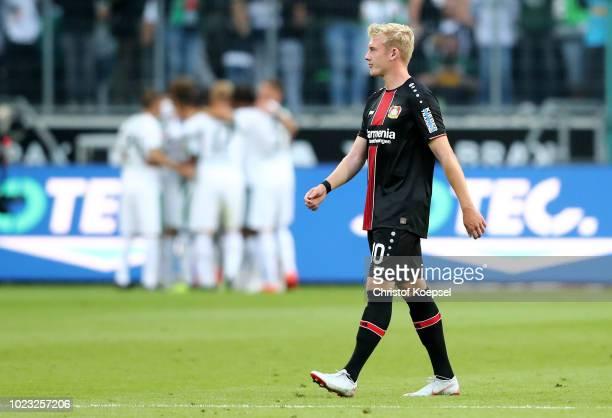 Julian Brandt of Leverkusen looks dejected after the first goal of Moenchengladbach during the Bundesliga match between Borussia Moenchengladbach and...