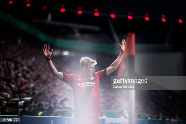 Julian Brandt of Leverkusen prepares a corner kick during the DFB Cup semi final match between Bayer 04 Leverkusen and Bayern Muenchen at BayArena on...