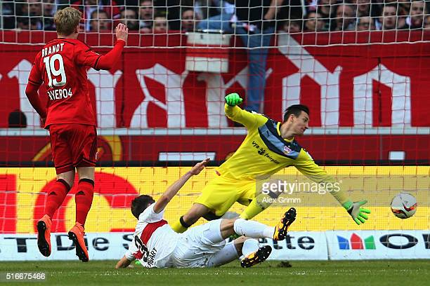 Julian Brandt of Leverkusen scores his team's first goal against Daniel Schwaab and goalkeeper Przemyslaw Tyton of Stuttgart during the Bundesliga...