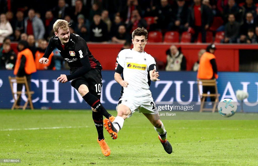Julian Brandt of Leverkusen scores his teams second goal during the Bundesliga match between Bayer 04 Leverkusen and Borussia Moenchengladbach at BayArena on March 10, 2018 in Leverkusen, Germany.