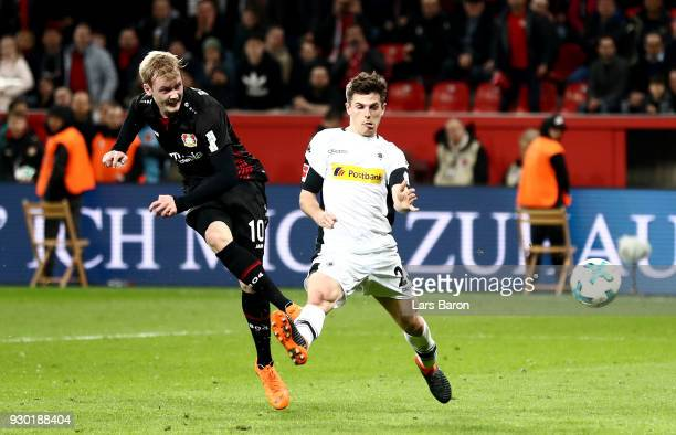 Julian Brandt of Leverkusen scores his teams second goal during the Bundesliga match between Bayer 04 Leverkusen and Borussia Moenchengladbach at...