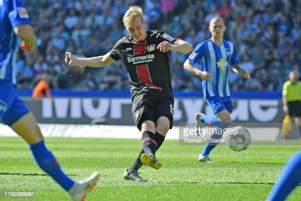 Julian Brandt of Leverkusen scores his teams third goal during the Bundesliga match between Hertha BSC and Bayer 04 Leverkusen at Olympiastadion on...
