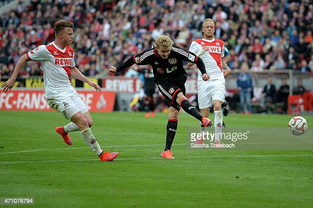 Julian Brandt of Leverkusen scores the opening goal during the Bundesliga match between 1. FC Koeln and Bayer 04 Leverkusen at RheinEnergieStadion on...