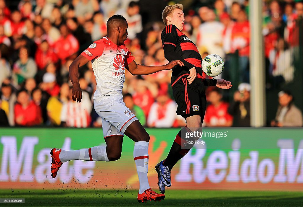 Julian Brandt #19 of the Bayer Leverkusen in action against Fernando Mina #26 of the Indepediente Santa Fe during the match at the ESPN Wide World of Sports Complex on January 10, 2016 in Kissimmee, Florida.
