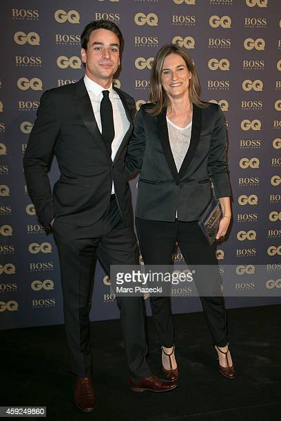 Julian Bugier and Claire Fournier attend the 'GQ Men of the Year 2014' photocall at Musee d'Orsay on November 19 2014 in Paris France