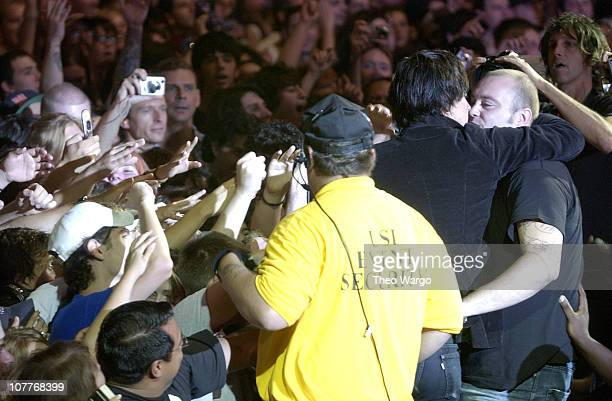 Julian Casablancas of The Strokes kisses a security guard
