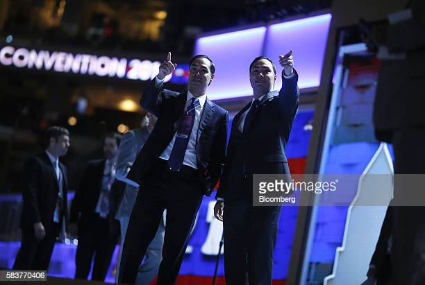 Julian Castro secretary of US Housing and Urban Development and Representative Joaquin Castro a Democrat from Texas gesture on stage during a walk...