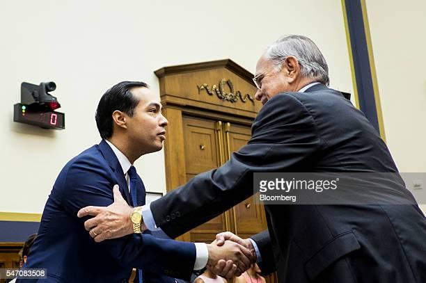 Julian Castro secretary of US Housing and Urban Development left shakes hands with Representative Ruben Hinojosa a Democrat from Texas before the...