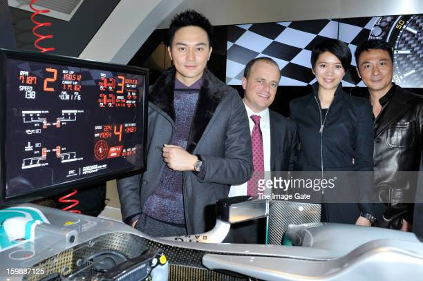 Julian Cheung, guest, Anita Yuen and Francis Ng visit the IWC booth during the Salon International de la Haute Horlogerie 2013 at Palexpo on January...