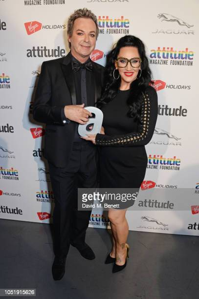 Julian Clary and Michelle Visage pose in the winners room at The Virgin Holidays Attitude Awards at The Roundhouse on October 11 2018 in London...