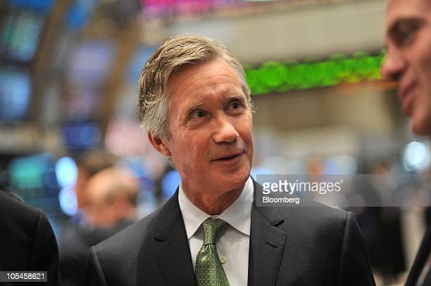 Julian Day chief executive officer of RadioShack Corp talks to traders on the floor of the New York Stock Exchange after the opening bell in New York...