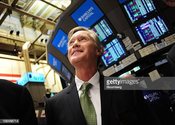 Julian Day chief executive officer of RadioShack Corp walks the floor of the New York Stock Exchange after the opening bell in New York US on...