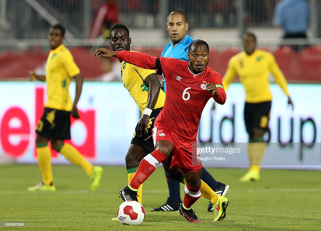 Julian De Guzman of Canada battles for the ball during the International Friendly match between Canada and Jamaica at BMO Field on September 09, 2014 in Toronto, Ontario, Canada.