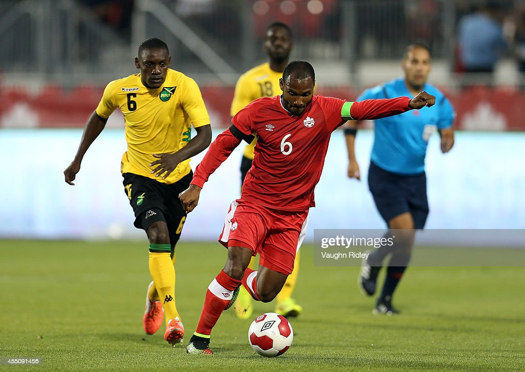 Julian De Guzman of Canada has a shot at goal during the International Friendly match between Canada and Jamaica at BMO Field on September 09, 2014 in Toronto, Ontario, Canada.