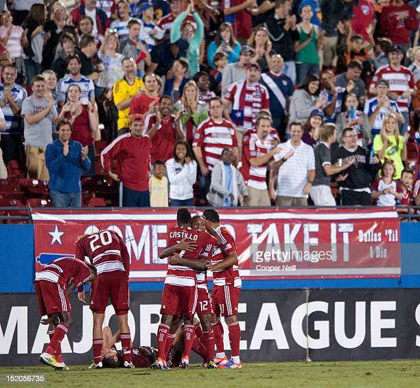 Julian de Guzman of FC Dallas celebrates the game winning goal with teammates against the Vancouver Whitecaps FC on September 15 2012 at FC Dallas...