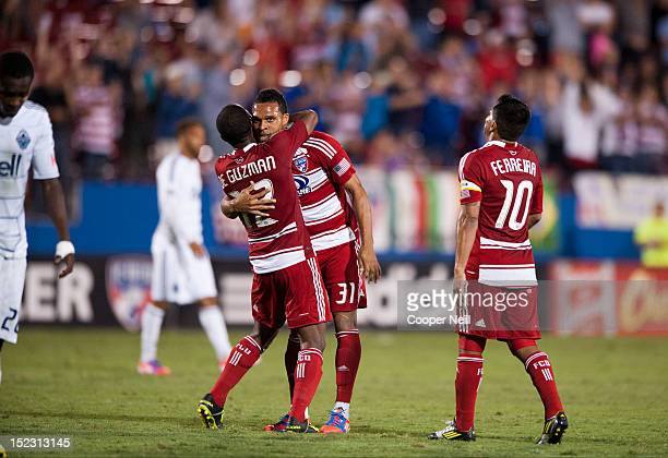 Julian de Guzman of FC Dallas celebrates the game winning goal with teammates Scott Sealy and David Ferreira after defeating the Vancouver Whitecaps...