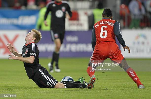 Julian de Guzman of the Toronto FC takes down Dax McCarty of D.C. United in a game on April 16, 2011 at BMO Field in Toronto, Canada. D.C. United...