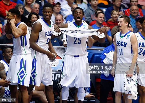 Julian DeBose of the Florida Gulf Coast Eagles Demetris Morant Marc Eddy Norelia and Christian Terrell celebrate defeating the Fairleigh Dickinson...