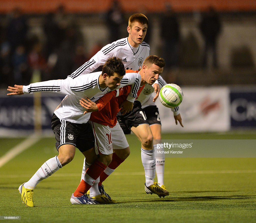 Julian Derstroff (L) and Robin Knoche of Germany in action with Mergim Brahimi (C) of Switzerland during the international friendly match between U20 Switzerland and U20 Germany at Eps Stadium on March 26, 2013 in Baden, Switzerland.