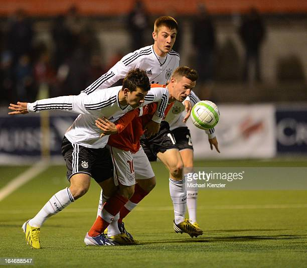 Julian Derstroff and Robin Knoche of Germany in action with Mergim Brahimi of Switzerland during the international friendly match between U20...