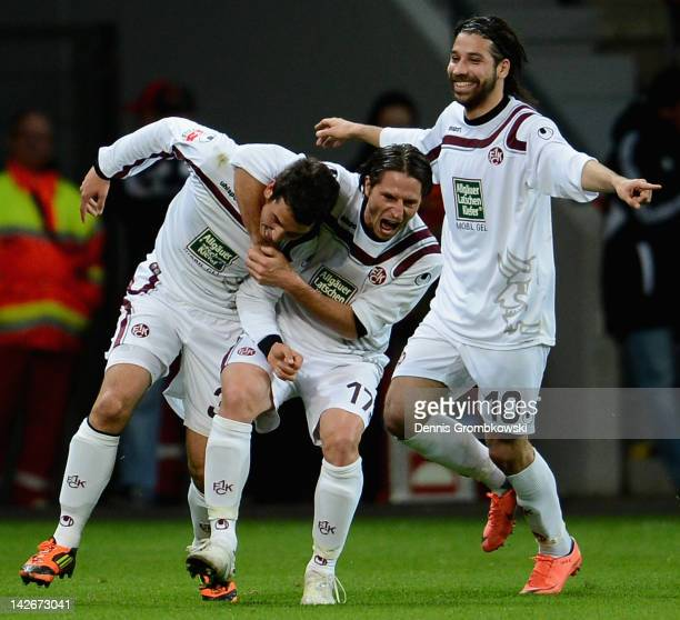 Julian Derstroff of Kaiserslautern celebrates with teammates Alexander Bugera and Olcay Sahan after scoring his team's first goal during the...