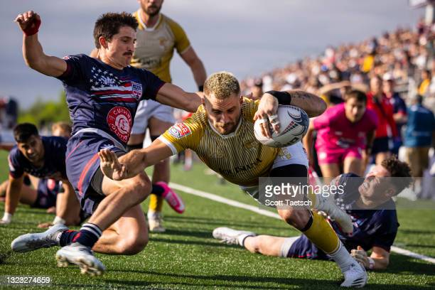 Julian Dominguez of NOLA Gold dives to score a try against Old Glory DC during the second half of the match at Segra Field on June 12, 2021 in...