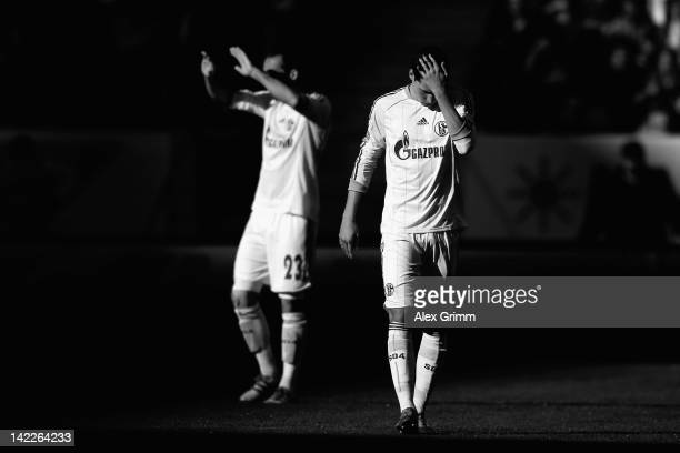 Julian Draxler and Christian Fuchs of Schalke react during the Bundesliga match between 1899 Hoffenheim and FC Schalke 04 at RheinNeckarArena on...
